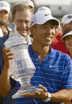 Anthony Kim of the U.S. holds his crystal trophy after a one-hole play-off win at the Houston Open golf tournament in Houston April 4, 2010. REUTERS/Richard Carso