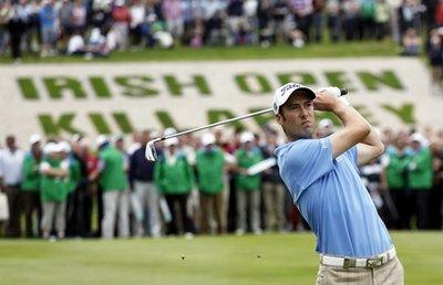 England's Ross Fisher plays his second shot on the 18th hole during the final round of the Irish Open Golf Championship at Killarney Golf and Fishing Club, Ireland, Sunday, Aug. 1, 2010.(AP Photo/Peter Morrison)
