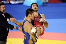 Chinese wrestler carries injured opponent out of court in arms