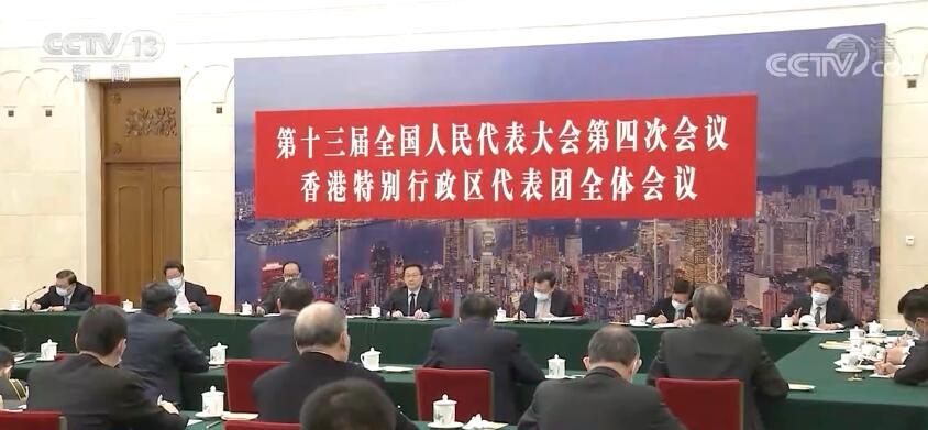 韩正分别参加香港代表团、澳门代表团审议