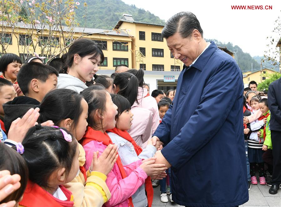 Chinese President Xi Jinping, also general secretary of the Communist Party of China Central Committee and chairman of the Central Military Commission, talks with students at a primary school in Zhongyi Township of Shizhu Tujia Autonomous County, southwest China