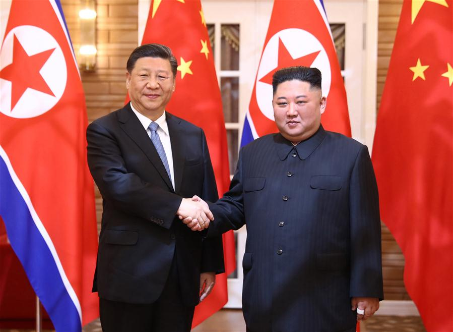 Xi Jinping, general secretary of the Central Committee of the Communist Party of China (CPC) and Chinese president, holds talks with Kim Jong Un, chairman of the Workers
