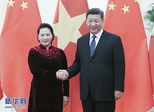 7月12日,国家主席习近平在北京人民大会堂会见越南国会主席阮氏金银。 新华社记者姚大伟摄