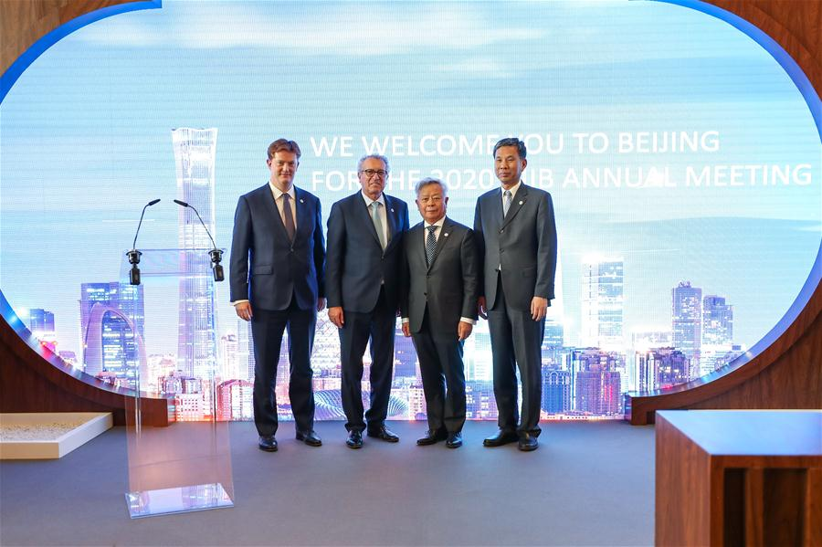 Jin Liqun (2nd R), president of Asian Infrastructure Investment Bank (AIIB), Chinese Finance Minister Liu Kun (1st R) and Pierre Gramegna (2nd L), Luxembourg
