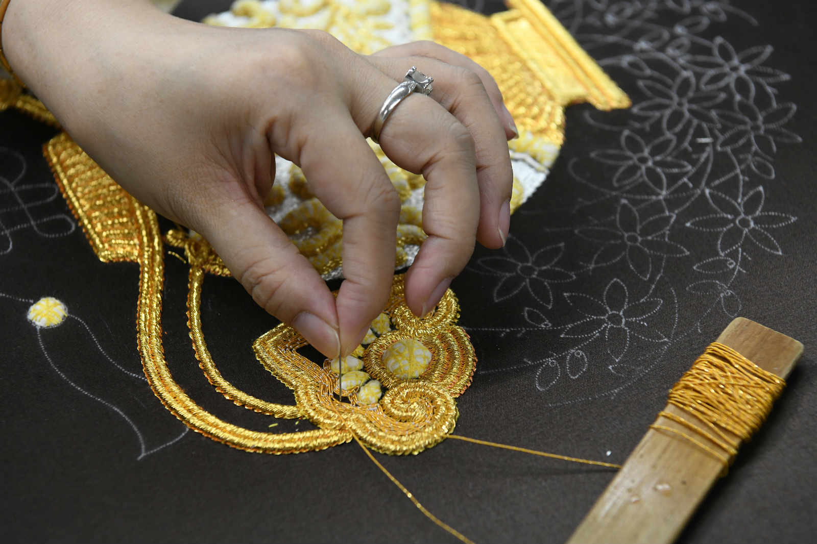 She Keyan, the official heir to the national heritage of Chao Embroidery, works on a piece of Chao Embroidery at her workshop in Chaozhou, south China