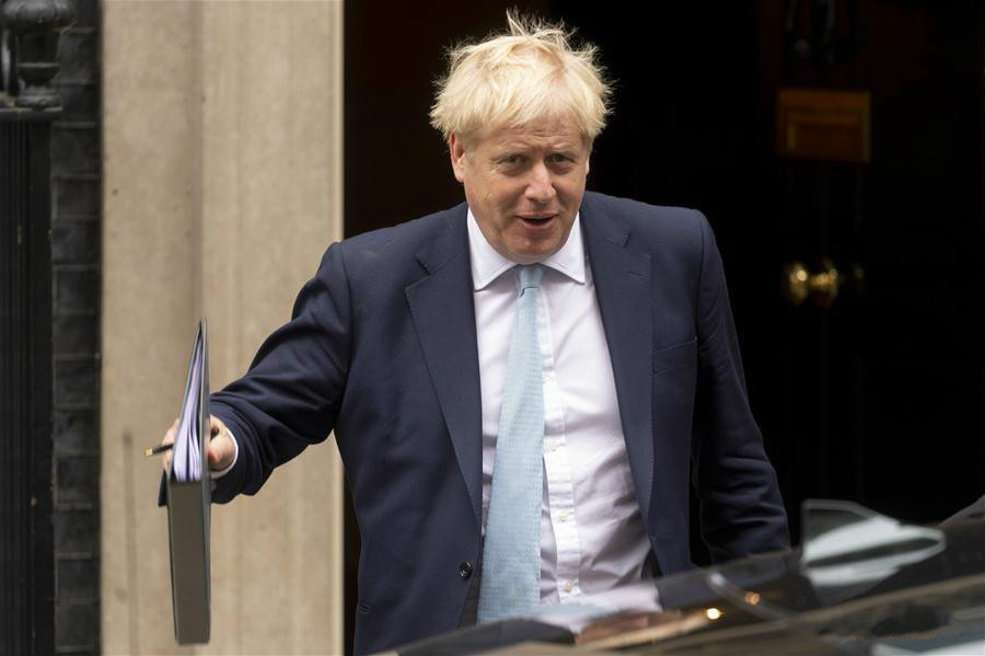 British Prime Minister Boris Johnson leaves 10 Downing Street in London, Britain, on Oct. 3, 2019. British Prime Minister Boris Johnson urged politicians in the House of Commons Thursday to back the new proposals he has submitted to Brussels to pave the way for Britain to leave the European Union on Oct. 31. (Photo by Ray Tang/Xinhua)